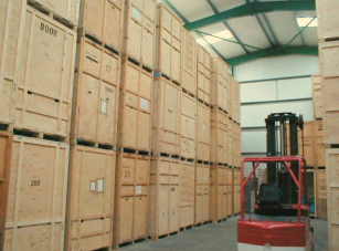 Wooden Storage Containers Are Stacked On Top Of Each Other.