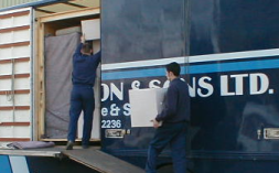 Southerington's removal men load boxes safely on to the van.
