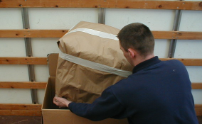 After being wrapped, smaller items are placed in boxes for easy, safe stacking on the van.