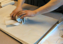 Breakable items are wrapped safely with paper.